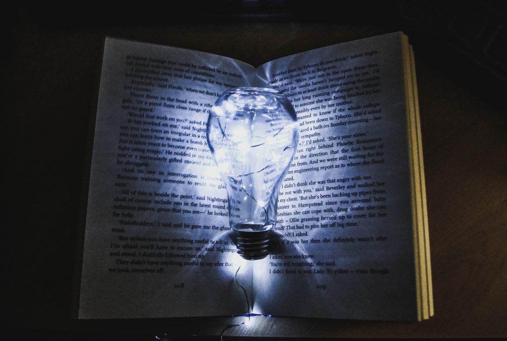 a light bulb on a book